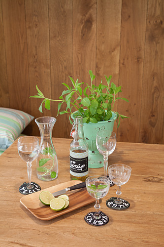 Name tags made from chalkboard fabric on wine glasses