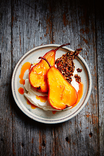 Safron baked pears with seed praline and labne