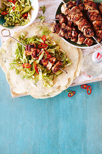 Asian five-spice chicken skewers with coriander pancakes