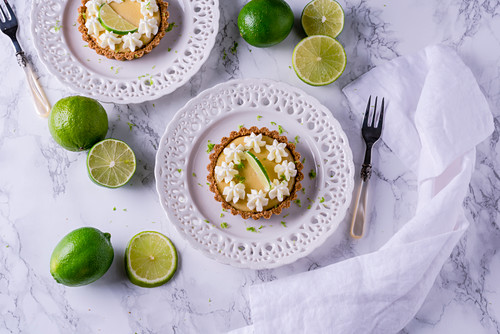 Key lime pie tartlets with cream flowers
