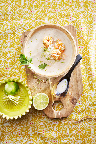 Coconut and lime soup with prawns and rice (top view)
