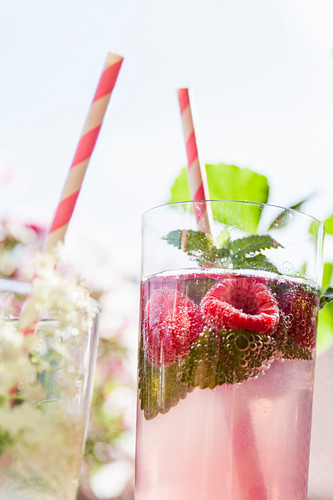 A glass of raspberry and mint infused water