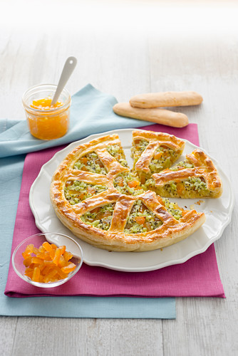 A puff pastry cake with kiwi, apple and candied orange peel