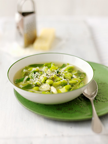 Spring vegetable soup with grated cheese