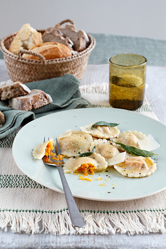 Pumpkin ravioli with sage and bread
