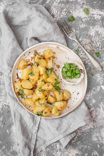 Indian style pan fried potatoes served with cilantro