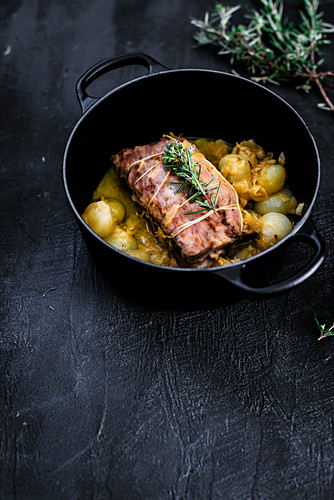 Iberian traditional roast pork, cooked with stuffed cheese and quince