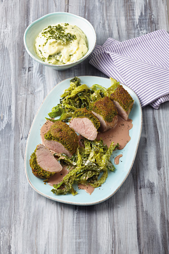 Pork fillets with a parsley and pistachio crust