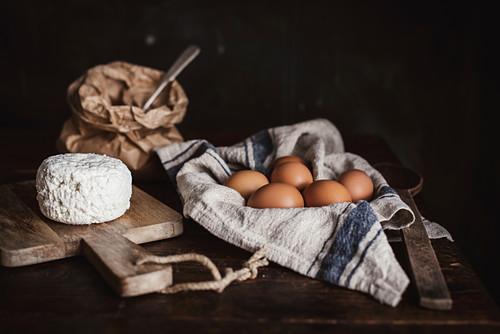 Still life with flour, egges and cottage cheese