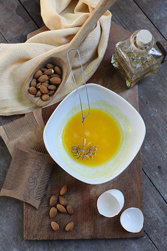 A nourishing hair mask made from almond oil, arnica flowers and egg yolks for treating dandruff