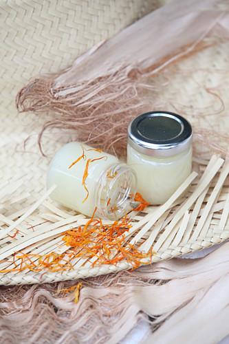 Two jars of homemade marigold salve