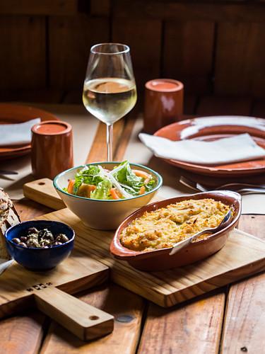 Spiritual codfish (bacalhau espiritual), a traditional Portuguese dish, with side salad