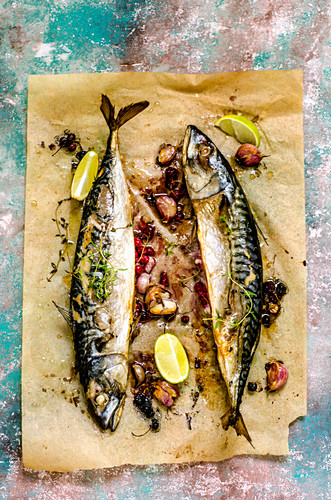 Baked Mackerel Fish with Herbs and Lemon on a colorful surface