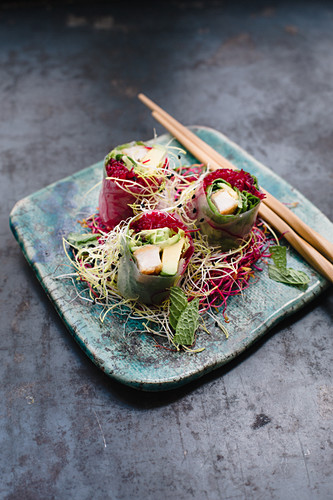 Rice paper rolls filled with chicken escalope, beetroot rice noodles, lettuce, avocado, coriander and mint