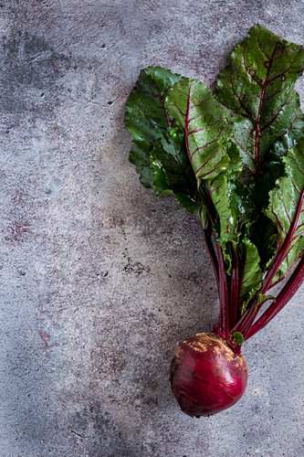 A beetroot on a concrete surface