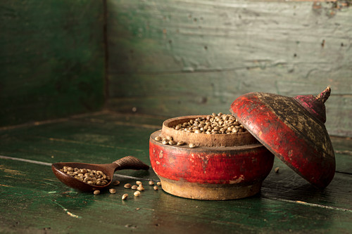 Hemp seeds in an old wooden bowl