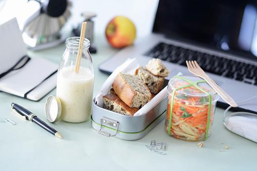 A mango and banana smoothie, banana bread and an apple and carrot salad