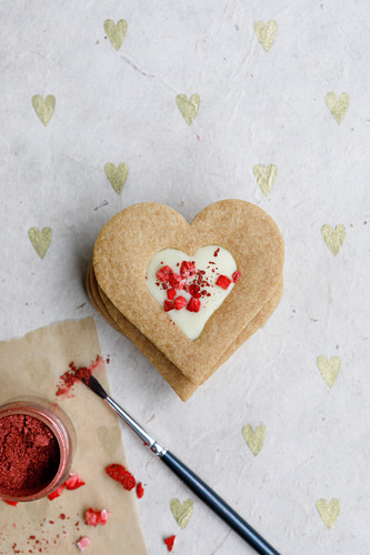 White chocolate centered heart biscuits with freeze dried strawberries and glitter to decorate