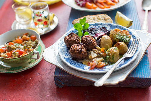 Middle easterrn supper with chickpea falafel, mutabal dip, roast potatoes and beetroot crips