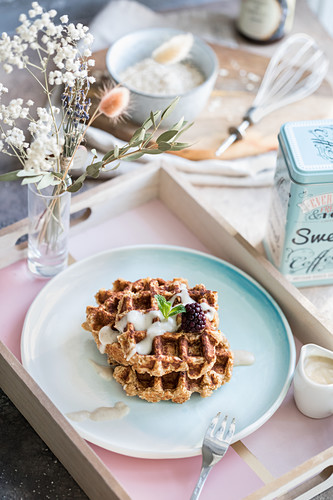 Wholemeal waffles with yoghurt sauce and blackberries