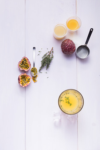 Ingredients for a passion fruit mocktail with thyme