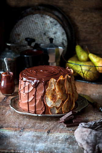 Chocolate cake with blue cheese baked cheesecake layer and pears