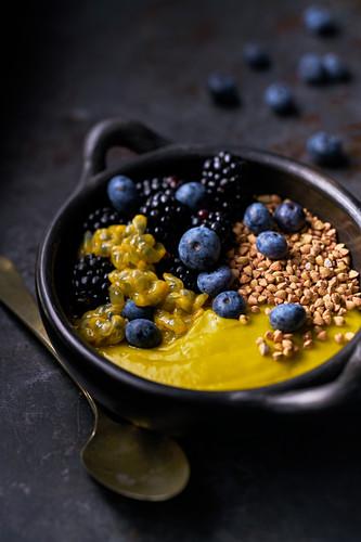 Breakfast bowl With mashed Avocado Mango, passion fruit, roasted buckwheat