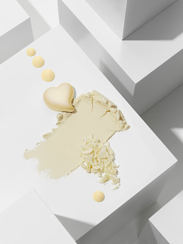 A white chocolate heart with various chocolate textures