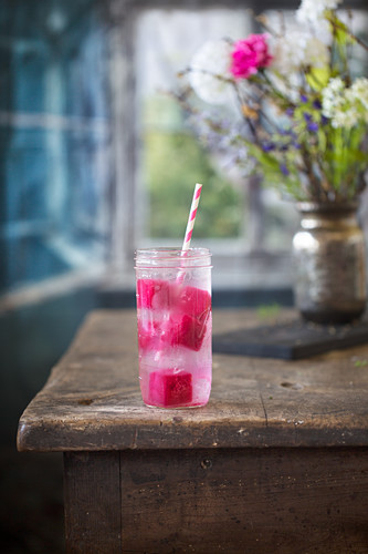 Rhubarb lemonade on a rustic wooden table