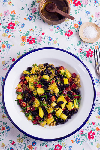 A Buddha bowl with quinoa, beans, pepper and mango