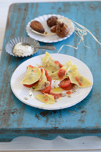 Ravioli with tomatoes and sunflower seeds