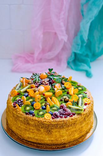 A festive fruit cake with kiwis and kumquats