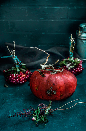 A pumpkin and bunches of berries