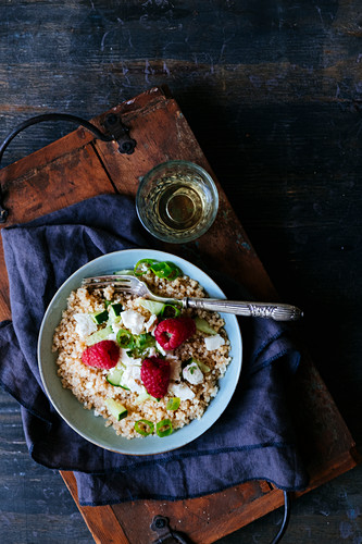 Quinoa with white cheese and raspberries