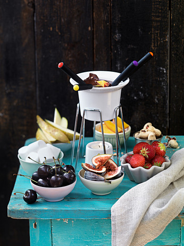 Chocolate fondue with fruit and marshmallows