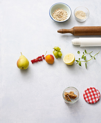 Ingredients for fruit salad with oat and sesame seed brittle