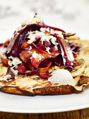 Potato pancakes with purple carrots and hazelnuts