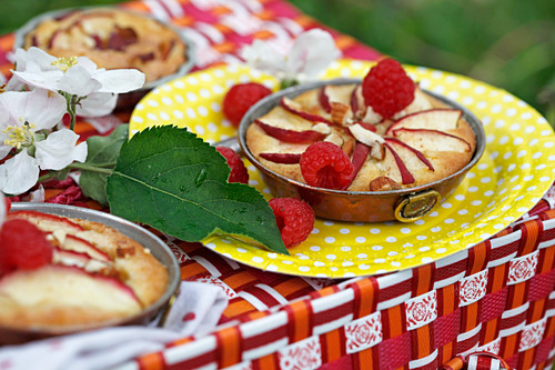 Small apple pies with raspberries for a summer picnic