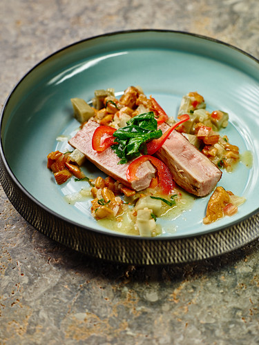 Lamb topped with artichokes, pointed peppers and chanterelles