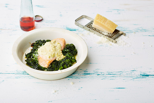 Gratinated mustard salmon on a bed of spinach