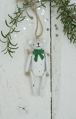 Christmas teddy bear and sprig of rosemary