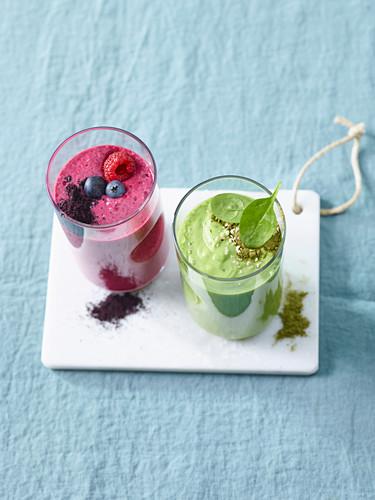 A berry smoothie made with acai powder and chia seeds and a green smoothie made with spinach, avocado and moringa