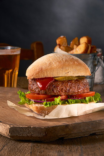 A hamburger with french fries and beer