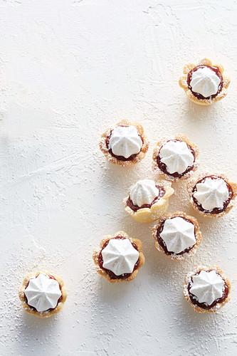 Almond and raspberry meringue tarts