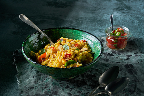 Roasted cauliflower couscous with tomatoes, almond flakes, coriander and green pepper