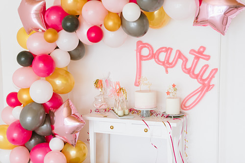 DIY balloon garland in party room