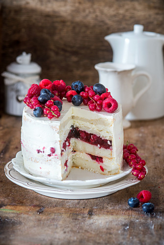 Angel food cake with berry jelly and buttercream