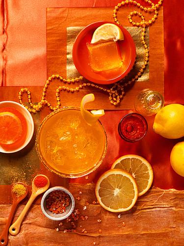 Orange jelly and orange juice on an orange background