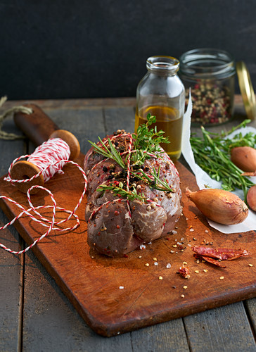 Raw, tied beef fillet prepared with herbs and various other ingredients