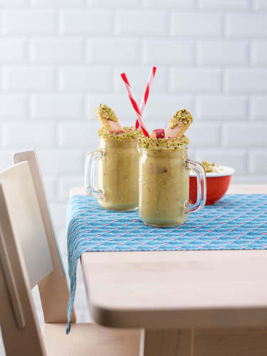 Peach and banana smoothie with sponge fingers and pistachio nuts